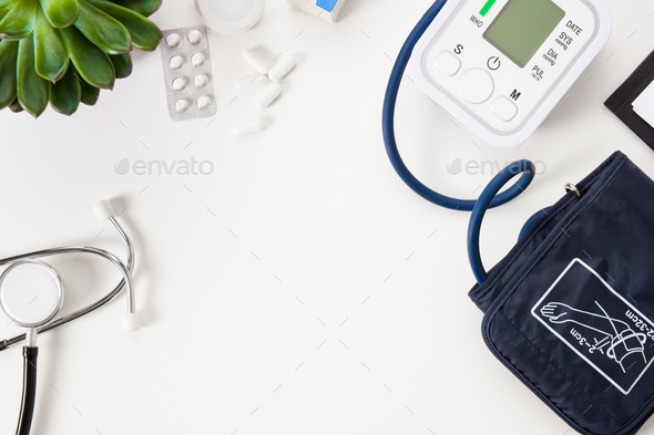 Doctors Office Desk with Blood Pressure Instrument and Stethoscope - Stock Photo - Images