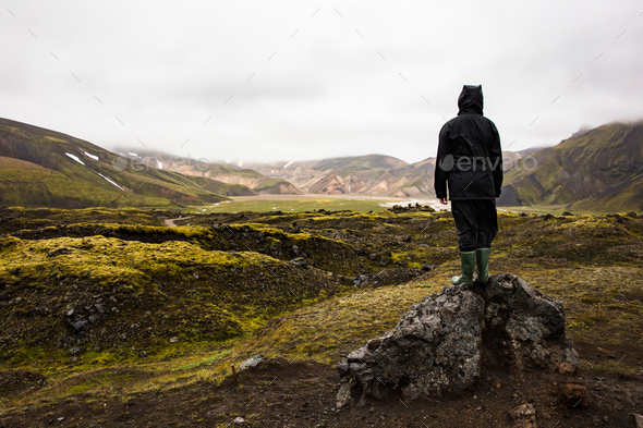 Female Hiker Standing On Rock While Enjoying Nature At Iceland - Stock Photo - Images