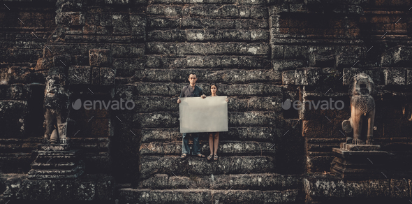 Young woman and man holding paper - Stock Photo - Images