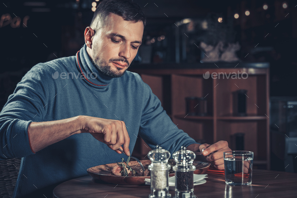 Handsome man at restaurant - Stock Photo - Images