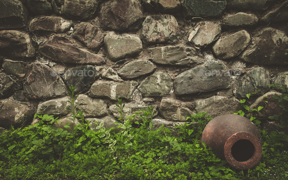 Stone wall texture background with ancient jar - Stock Photo - Images