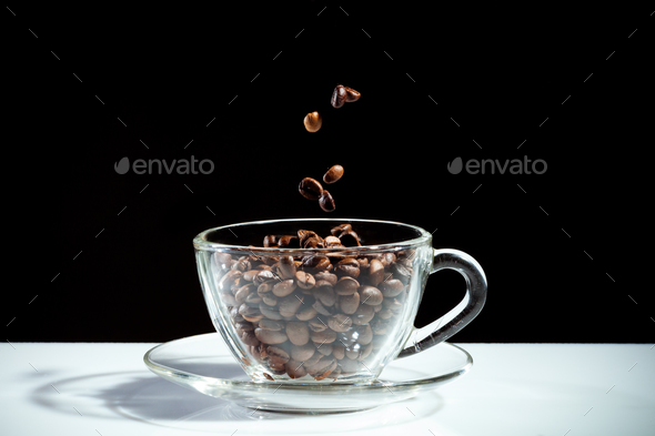 Coffee cup with falling beans - Stock Photo - Images