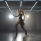 A Woman Is Dancing Energetically on the Dance Floor - VideoHive Item for Sale