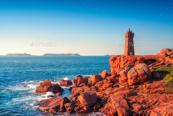 Ploumanach lighthouse sunset in pink granite coast, Brittany, Fr - Stock Photo - Images