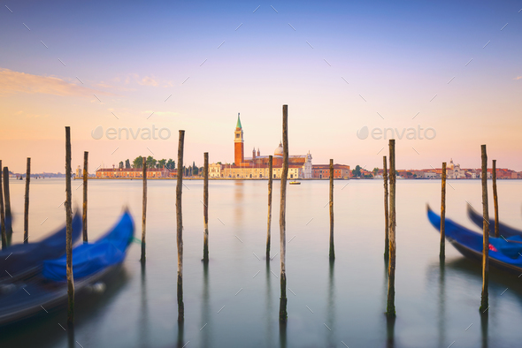 Venice lagoon, San Giorgio church, gondolas and poles. Italy - Stock Photo - Images