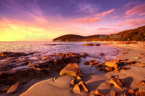 Sunset in Cala Violina bay beach in Maremma, Tuscany. Mediterran - Stock Photo - Images