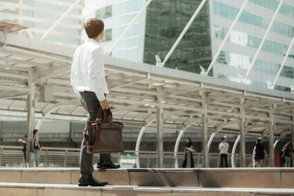Businessman are walking with sunlight - Stock Photo - Images