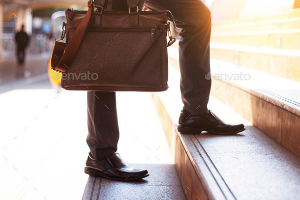 Businessman carrying a bag - Stock Photo - Images
