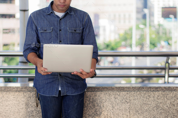 Man is standing with notebook - Stock Photo - Images