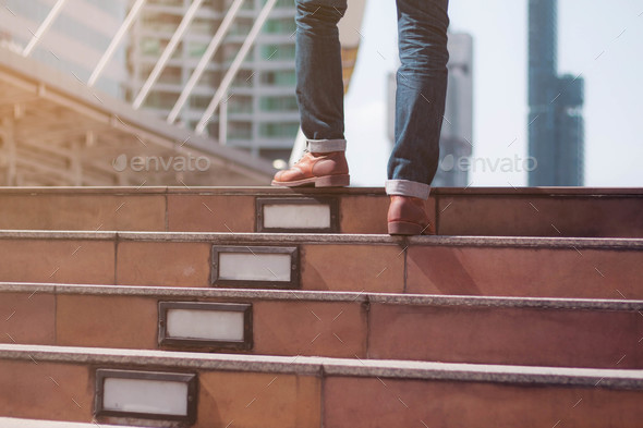 man was walking up stairs - Stock Photo - Images