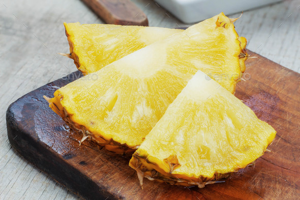 pineapple slices on wooden. - Stock Photo - Images