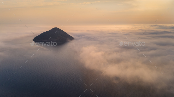 Kinira island in sunrise, Greece - Stock Photo - Images