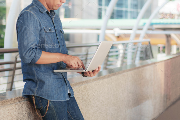 Young man holding notebook working - Stock Photo - Images