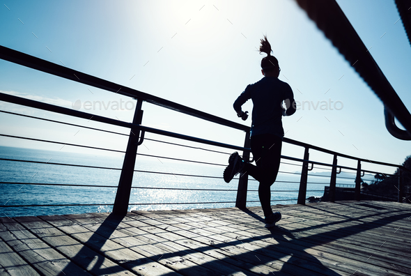 Running on seaside boardwalk - Stock Photo - Images