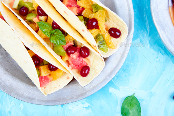 Fruit tacos. Summer snacks. - Stock Photo - Images