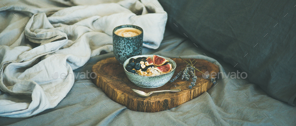 Rice coconut porridge and espresso in bed, wide composition - Stock Photo - Images