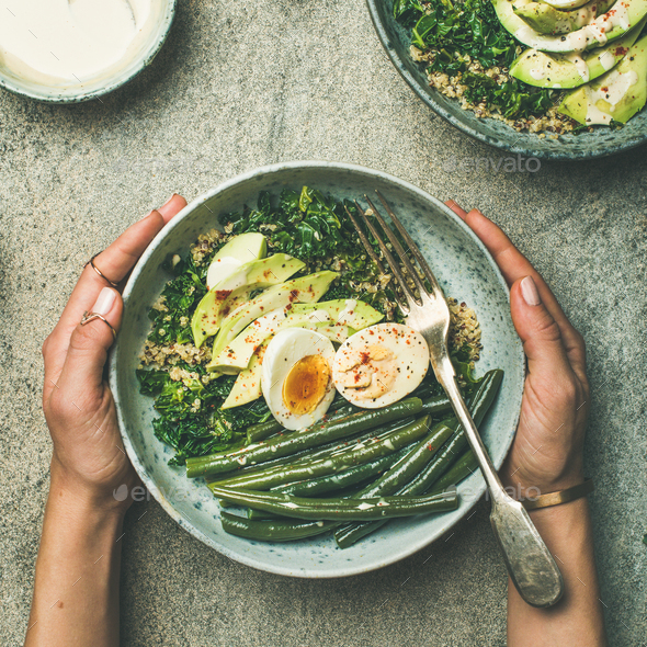 Quinoa, kale, green beans, avocado, egg bowls flat-lay, square crop - Stock Photo - Images