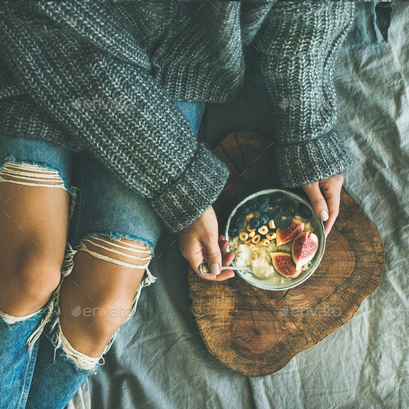 Healthy vegetarian winter breakfast in bed concept, top view - Stock Photo - Images