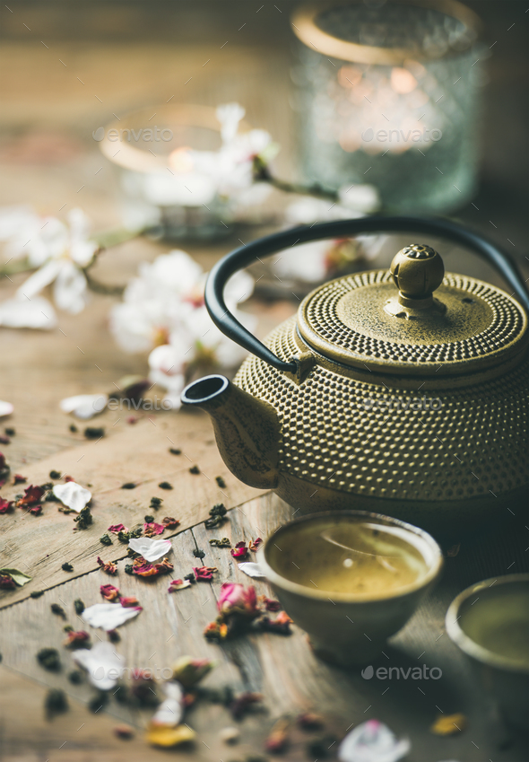 Traditional Asian tea ceremony arrangement over rustic background - Stock Photo - Images