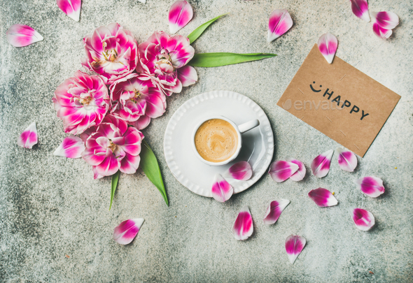 Cup of coffee surrounded with pink tulip flowers, marble background - Stock Photo - Images