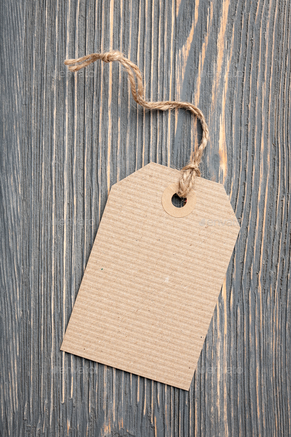 Paper tag on wooden background - Stock Photo - Images