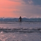 The Surfer Comes Into the Ocean at Background Beautiful Sunset. Balangan Beach, Bali, Indonesia - VideoHive Item for Sale