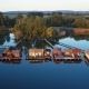 Flying Over Fishing Houses Line on the Lake Shore, Hungary. - VideoHive Item for Sale