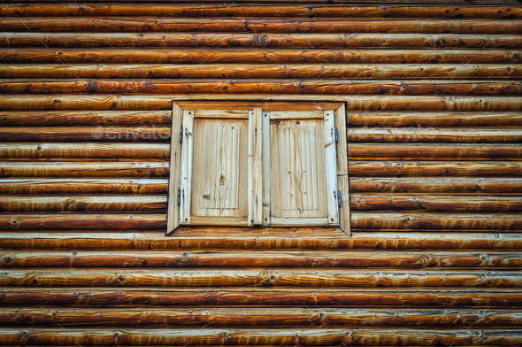 Weathered wooden log wall and wooden closed window shutters - Stock Photo - Images