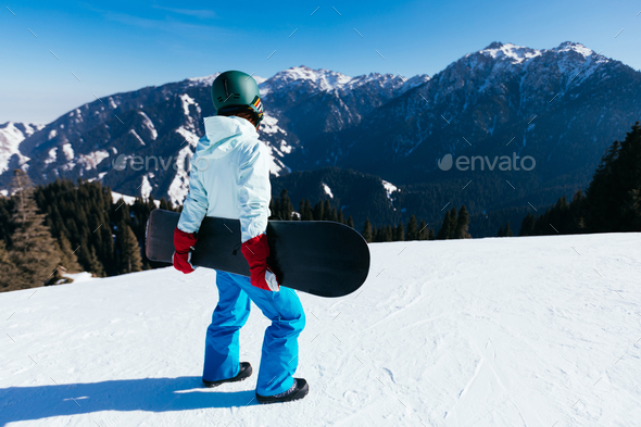 Snowboarder on alpine mountain top - Stock Photo - Images
