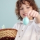 Boy with Easter Basket. Teenager Shows on His Outstretched Hand a Gently Blue Easter Egg - VideoHive Item for Sale