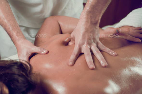Relaxing Shoulders and Back Massage - Stock Photo - Images