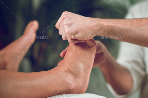 Relaxing Foot Massage - Stock Photo - Images