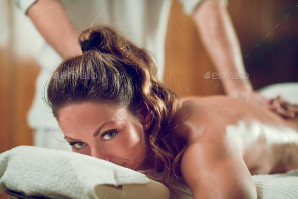 Female Enjoying Relaxing Back Massage - Stock Photo - Images