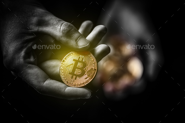 Golden Bitcoin in a man hand - Stock Photo - Images