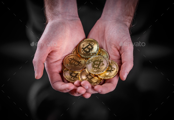 Man holding Bitcoin - Stock Photo - Images