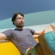 Young Man Sliding Down at the Aquapark - VideoHive Item for Sale