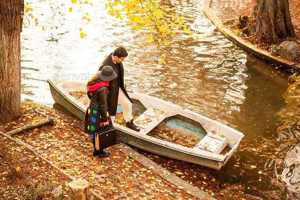 Couple next to a boat in park - Stock Photo - Images