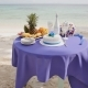 A Decorated Wedding Table with Fruits, Cake, Champagne and Wine Glasses on a Sandy Ocean Beach - VideoHive Item for Sale