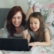 Happy Cute Daughter and Young Mother Have Online Video Call with Father or Grandmother Using Laptop - VideoHive Item for Sale