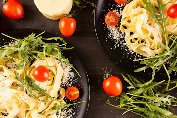 Top view of two plates with pasta - Stock Photo - Images