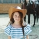 Portrait of a Smart Happy Girl Smiling at Camera at the Horse Area - VideoHive Item for Sale