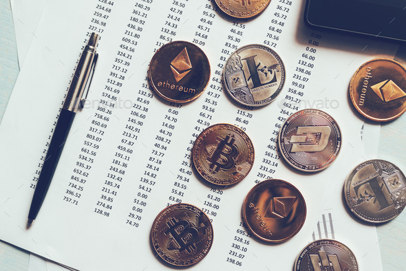 Cryptocurrency coins with exchange rate table - Stock Photo - Images