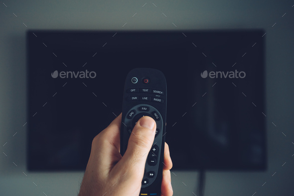 Male hand with TV remote controller - Stock Photo - Images