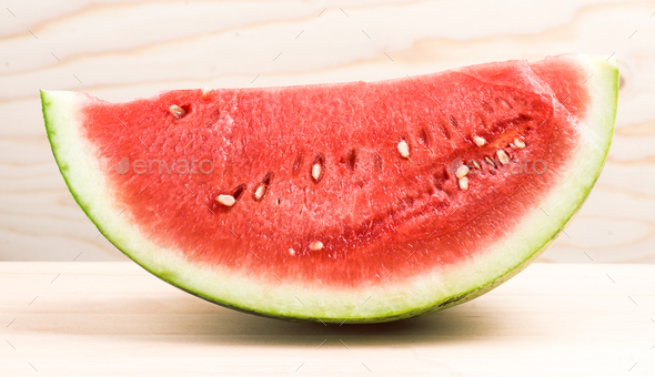 half watermelon on light wood - Stock Photo - Images