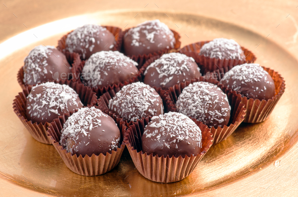 chocolates and grated coconut - Stock Photo - Images
