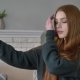 Young Beautiful Red-haired Teen Girl Uses a Smartphone, Makes Selfie, Home Comfort in the Background - VideoHive Item for Sale