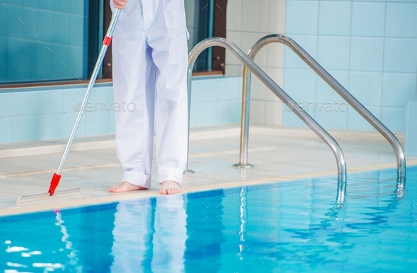 Swimming Pool Cleaning - Stock Photo - Images