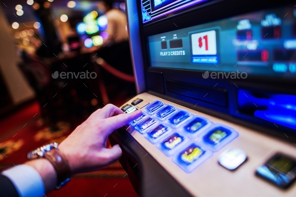 Men Playing Slot Machine - Stock Photo - Images
