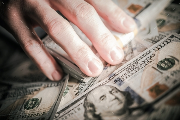 Hands on the Money - Stock Photo - Images