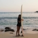 Girl Has Fun with Surfboard by the Ocean - VideoHive Item for Sale